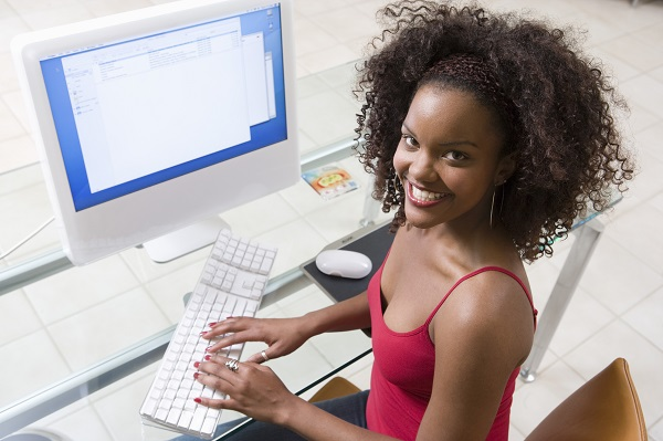 Young Woman Using Desktop Computer