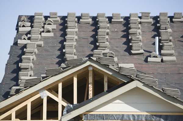 Stacks of tiles on house roof